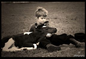 Dakota and his calf by TlCphotography730