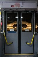 Through the Bus Doors 11 by bowtiephotography