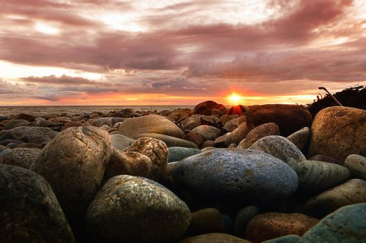 Sunset over Dinas Dinlle by Unclespikey