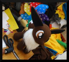 Finished Eevee on my Desk by Trinkety