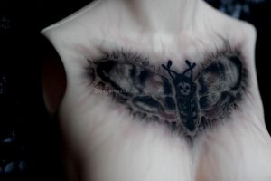 Old messy moth tattoo by Sarqq
