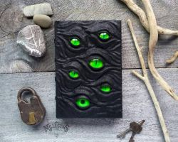 The Watcher's grimoire - Green eyes by MilleCuirs