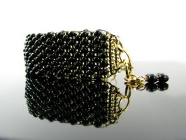 Bead loomed cuff with peanut and seed beads by CatsWire