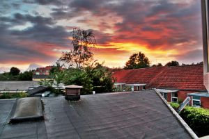 sunset over haderslev in dk. by mortenthoms
