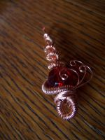 Red glass spice pendant by NikkelahGhaz