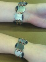 Peirced and Riveted Bracelet by ArtsyShan