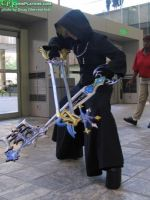 Roxas With his Keyblades by GingerAnneLondon