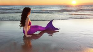Mermaid sitting on beach by KatDiVine22