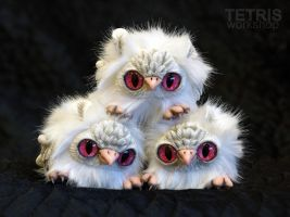 Pyramid of albino owl ball toys by KrafiCat